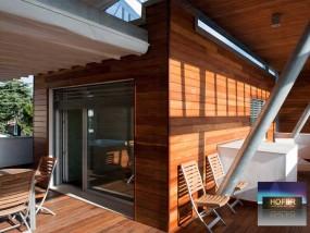 Holzfassade. Die dauerhafte Fassade aus Holz.